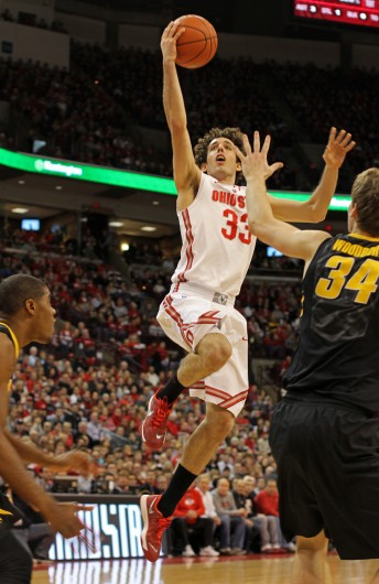 Sophomore guard Amedeo Della Valle (33) attempts a lay up during a game against Iowa Jan. 12 at the Schottenstein Center. OSU lost, 84-74. Credit: Shelby Lum / Photo editor