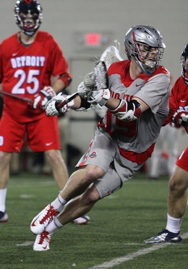 Then-sophomore midfielder Jesse King (19) advances the ball during a game against Detroit Feb. 9 at the Woody Hayes Athletic Center. OSU won, 14-8. Credit: Shelby Lum / Photo editor