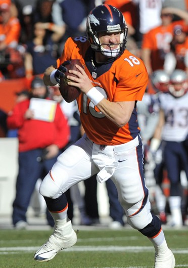 Denver Broncos quarterback Peyton Manning scans the field during the AFC championship game against the New England Patriots Jan. 19 at Sports Authority Field at Mile High. Denver won, 26-16. Courtesy of MCT