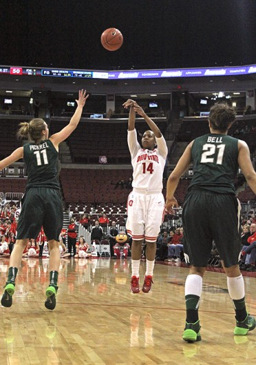 Sophomore guard Ameryst Alston (14) takes a shot during a game against Michigan State Jan. 26 at the Schottenstein Center. OSU lost, 82-68. Credit: Kaily Cunningham / Multimedia editor