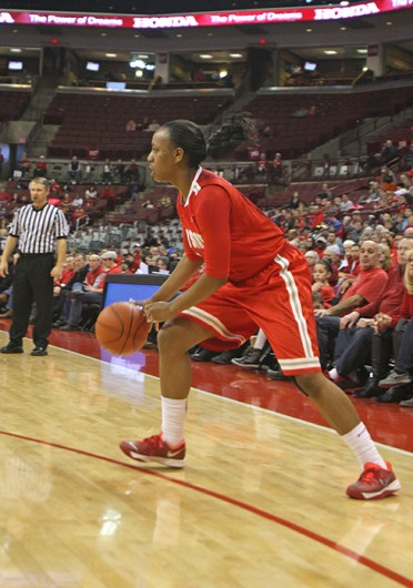 Sophomore guard Ameryst Alston (14) dribbles the ball during a game against Michigan Jan. 5 at the Schottenstein Center. OSU lost, 64-49. Credit: Shelby Lum / Photo editor