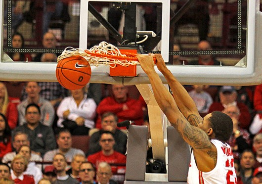 Junior center Amir Williams dunks the ball during a game against Iowa Jan. 12 at the Schottenstein Center. OSU lost, 84-74. Credit: Shelby Lum / Photo editor