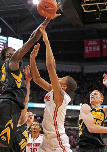 Freshman forward Marc Loving (2) has his shot blocked during a game against Iowa Jan. 12 at the Schottenstein Center. OSU lost, 84-74. Credit: Shelby Lum / Photo editor