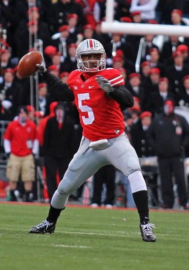 Junior quarterback Braxton Miller (5) throws the ball during a game against Indiana Nov. 23 at Ohio Stadium. OSU won, 42-14. Credit: Shelby Lum / Photo editor