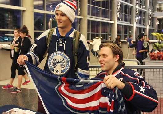 Columbus Blue Jackets defenseman Jack Johnson (left) poses for a photo with first year in exploration Brent Savan. Johnson was signing autographs Jan. 15 at the RPAC. Credit: Shelby Lum / Photo editor