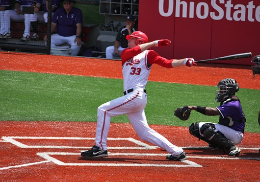 Then-sophomore pitcher and first baseman Josh Desze (33) hits the ball during a game against Northwestern May 6, 2012, at Bill Davis Stadium. OSU won, 4-1. Credit: Shelby Lum / Photo editor