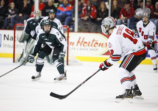 Junior forward Ryan Dzingel (18) prepares to shoot the puck during a game against Michigan State Jan. 11 at the Schottenstein Center. The teams tied, 1-1. Credit: Kelly Roderick / For The Lantern