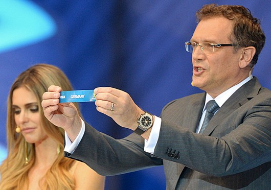 FIFA General Secretary Jerome Valcke (right) shows Germany's name during the 2014 FIFA World Cup Draw Dec. 6 in Costa do Sauipe, Brazil. Courtesy of MCT