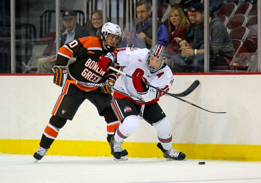 Junior forward Ryan Dzingel (18) passes the puck during a game against Bowling Green Oct. 29 at the Schottenstein Center. OSU won, 5-3. Credit: Shelby Lum / Photo editor