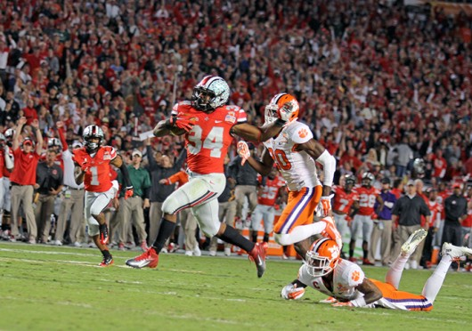 Senior running back Carlos Hyde (34) avoids a tackler during the 2014 Discover Orange Bowl against Clemson Jan. 3 at Sun Life Stadium. OSU lost, 40-35. Credit: Shelby Lum / Photo editor