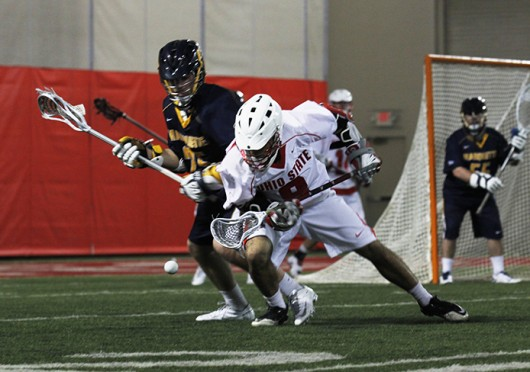 Then-sophomore attacker Reegan Comeault (8) fights for a loose ball during a game against Marquette Feb. 23 at the Woody Hayes Athletic Center. OSU won, 18-8. Credit: Shelby Lum / Photo editor