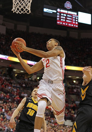 Freshman forward Marc Loving (2) attempts a lay up during a game against Iowa Jan. 12 at the Schottenstein Center. OSU lost, 84-74. Credit: Shelby Lum / Photo editor