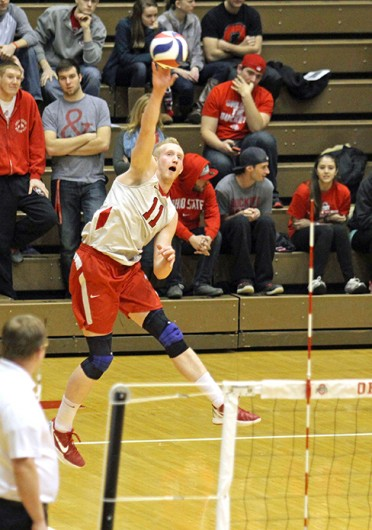 Redshirt-junior opposite Andrew Lutz (11) serves the ball during a match against Lees-McRae Jan. 17 at St. John Arena. OSU won, 3-0. Credit: Shelby Lum / Photo editor