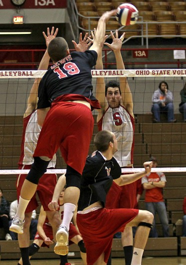 Then-sophomore middle blocker Grayson Overman attempts to block an opposing spike during a match against Lewis March 4, 2011, at St. John Arena. OSU won, 3-0. Credit: Cody Cousino / For The Lantern