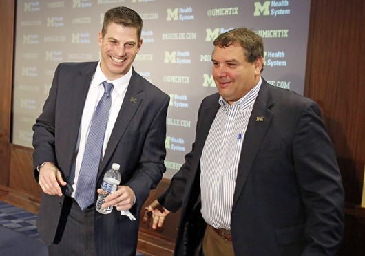 Michigan coach Brady Hoke (right) and offensive coordinator, Doug Nussmeier shake hands after a news conference in Ann Arbor, Mich., Jan. 10. Credit: Courtesy of MCT