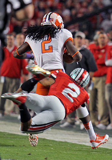 Junior linebacker Ryan Shazier (right) tackles Clemson junior wide receiver Sammy Watkins during the 2014 Discover Orange Bowl Jan. 3 at Sun Life Stadium. OSU lost, 40-35. Credit: Shelby Lum / Photo editor