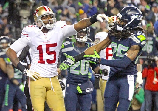 San Francisco 49ers wide receiver Michael Crabtree (left) pushes away Seattle Seahawks cornerback Richard Sherman during the NFC championship game Jan. 19 at CenturyLink Field. The Seahawks won, 23-17. Credit: Courtesy of MCT