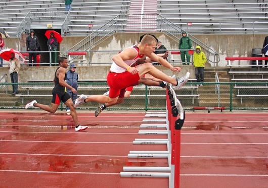 Then-redshirt-sophomore Cory Kunze jumps over a hurdle during the Jesse Owens Track Classic April 14, 2012, at Jesse Owens Memorial Field. Credit: Shelby Lum / Photo editor
