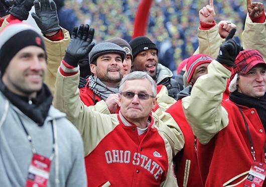 Former OSU football coach Jim Tressel waves to the fans during a game against Michigan Nov. 24, 2012, at Ohio Stadium. OSU won, 26-21. Lantern file photo