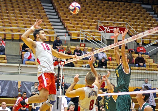 Junior middle blocker Dustan Neary (18) prepares to spike the ball during a match against Lees-McRae Jan. 17 at St. John Arena. OSU won, 3-0. Credit: Shelby Lum / Photo editor
