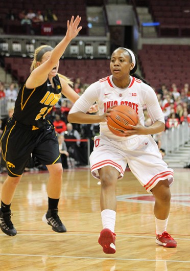 Sophomore guard Ameryst Alston (14) drives to the basket during a game against Iowa Jan. 19 at the Schottenstein Center. OSU lost, 81-74. Credit: Ryan Robey / For The Lantern
