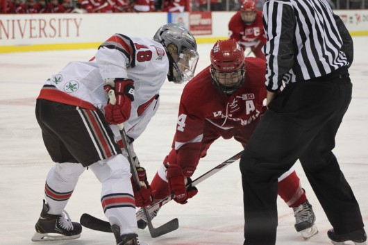 Junior forward Ryan Dzingel (18) prepares for a faceoff during a game against Wisconsin Feb. 15 at the Schottenstein Center. OSU lost, 4-2. Credit: Ryan Robey / For The Lantern