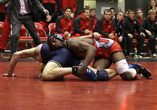 Sophomore Matt Martin takes down his opponent during a match against Michigan Jan. 31 at St. John Arena. OSU lost, 21-12. Credit Shelby Lum / Photo editor