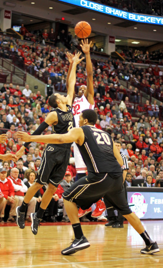 Senior guard Lenzelle Smith Jr. (32) shoots over a defender during a game against Purdue Feb. 8 at the Schottenstein Center. OSU won, 67-49. Credit: Shelby Lum / Photo editor