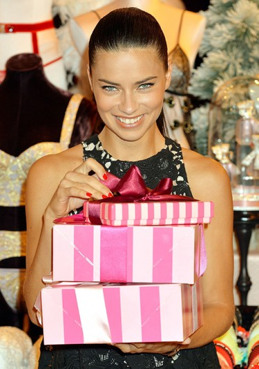 Model Adriana Lima with Victoria's Secret Christmas goods at the New Bond Street store in central London Dec. 12.  Credit: Courtesy of MCT