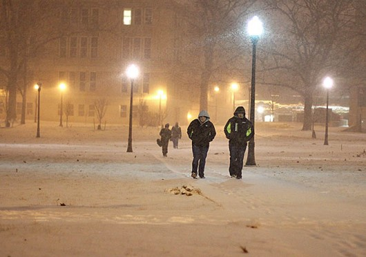 Students walk across a snowy Oval Feb. 4. Classes were canceled at OSU's main and branch campuses Jan. 6, 7 and 28 because of cold weather. OSU officials later announced professors would have the option of making up  missed classes. Credit: Shelby Lum / Photo editor