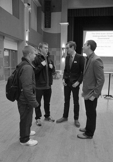 (From left) Nick Brausch, Russell Patterson, Nick Macek and Vytas Aukstuolis talk at a USG campaigning event Feb. 17. Credit: Thy Thy Nguyen / Lantern reporter