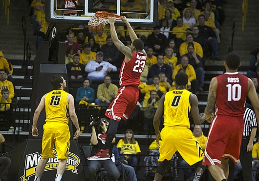 Junior center Amir Williams (23) dunks the ball during a game against Iowa Feb. 4 at Carver-Hawkeye Arena. OSU won, 76-69. Courtesty of The Daily Iowan/Alyssa Hitchcock