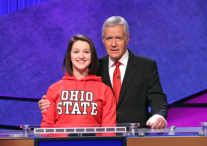Maria Khrakovsky, fourth-year in accounting and French, poses with Alex Trebek. Credit: Courtesy of Jeopardy Productions, Inc.