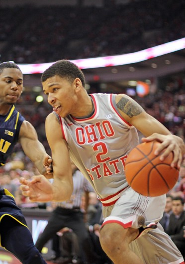 Freshman forward Marc Loving (2) drives to the basket during a game against Michigan Feb. 11 at the Schottenstein Center. OSU lost, 70-60. Credit: Shelby Lum / Photo editor
