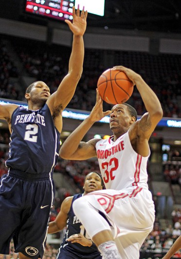 Senior guard Lenzelle Smith Jr. (32) drives to the basket during a game against Penn State Jan. 29 at the Schottenstein Center. OSU lost, 71-70. Credit: Shelby Lum / Photo editor