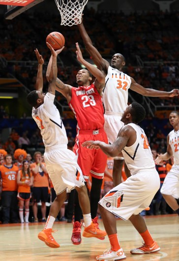 Junior center Amir Williams (23) reaches up for a shot. OSU beat Illinois, 48-39, Feb. 15 at the State Farm Center in Champaign, Ill. Courtesy of Brenton Tse / The Daily Illini