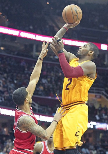 Cleveland Cavaliers guard Kyrie Irving attempts a shot during a game against the Chicago Bulls Jan. 22 at Quicken Loans Arena. The Cavaliers lost, 98-87. Courtesy of MCT
