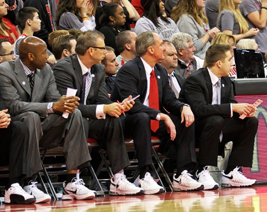 OSU coaches (from left) Dave Dickerson, Jeff Boals, Thad Matta and Greg Paulus look on during a game against Penn State Jan. 29 at the Schottenstein Center. OSU lost, 71-70, in overtime. The coaches wore tennis shoes to show support for Coaches v. Cancer. Credit: Shelby Lum / Photo editor