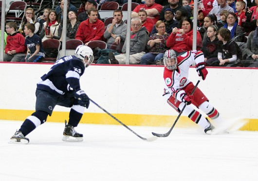 Junior forward Darik Angeli (10) races to the puck during a game against Penn State Feb. 1 at the Schottenstein Center. OSU won, 5-2. Credit: Alexis Hill / Lantern photographer