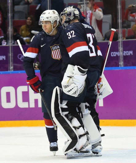 U.S. forward Joe Pavelski (left) and goalie Jonathan Quick greet each other following their lost to Finland in the men's Bronze Medal hockey game at the Winter Olympics in Sochi, Russia, Feb. 22. Finland defeated USA 5-0. Courtesy of MCT