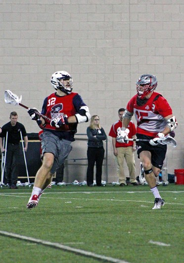 Senior midfielder Nick Diegel (15) attempts to stop an opposing player during a game against Robert Morris Feb. 1 at the Woody Hayes Athletic Center. OSU won, 11-7. Credit: Ryan Robey / For The Lantern