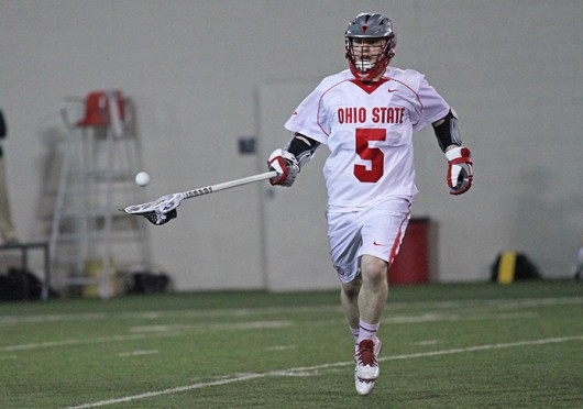 Junior midfielder Turner Evans tosses a pass to a teammate during a game against Marquette Feb. 22 at the Woody Hayes Athletic Center. OSU won, 11-7. Credit: Brett Amadon / Lantern reporter
