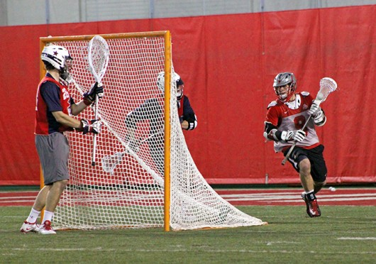 Junior attackman Reegan Comeault (8) looks for an open teammate during a game against Robert Morris Feb. 1 at the Woody Hayes Athletic Center. OSU won, 11-7. Credit: Ryan Robey / For The Lantern