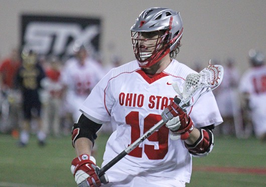 Junior midfielder Jesse King (19) cradles the ball during a game against Marquette Feb. 22 at the Woody Hayes Athletic Center. OSU won, 11-7. Credit: Brett Amadon / Lantern reporter