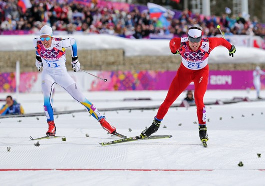 Swiss skier Dario Cologna (right) rushes to the finish during the Cross-Country Men's Skiathlon Feb. 9 at the 2014 Olympic Games in Sochi, Russia. Cologna won the race with a time of 1:08:15.4. Courtesy of MCT