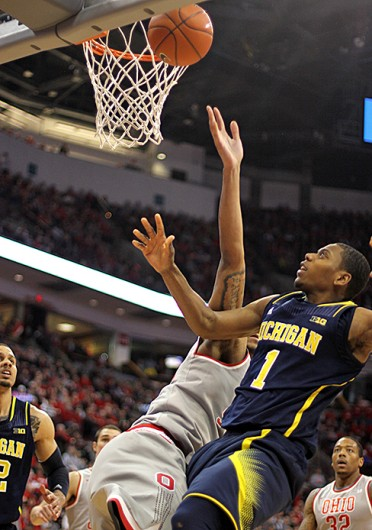 Sophomore Michigan forward Glenn Robinson III goes for a rebound during a game against Ohio State Feb. 11 at the Schottenstein Center. OSU lost, 70-60. Credit: Shelby Lum / Photo editor
