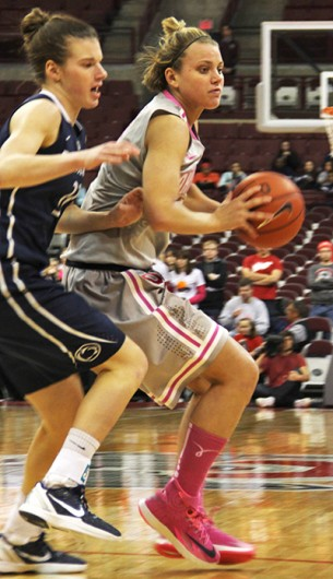 Redshirt-junior guard Amy Scullion (right) looks for an open teammate during a game against Penn State Feb. 9 at the Schottenstein Center. OSU won, 74-54. Credit: Ritika Shah / Asst. photo editor