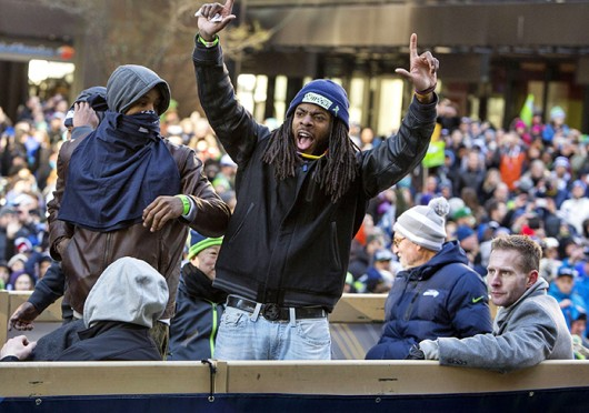 Seattle Seahawks cornerback Richard Sherman waves to the crowd during the Super Bowl Parade Feb. 5 in Seattle. Courtesy of MCT