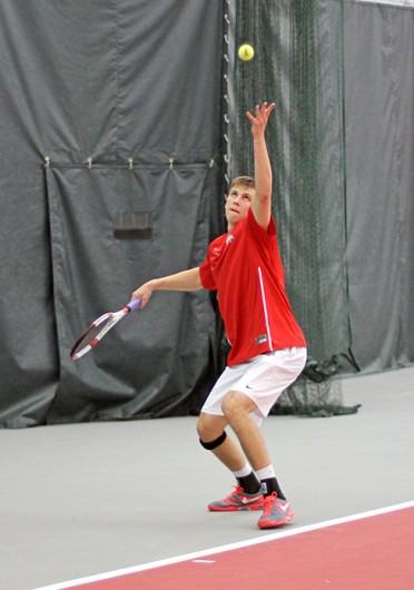 Senior Peter Kobelt serves the ball during a match against Xavier Jan. 22 at the Varsity Tennis Center. OSU won, 7-0. Credit: Shelby Lum / Photo editor