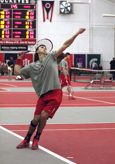 Senior Peter Kobelt serves the ball during a match against Texas A&M Feb. 9 at the Varsity Tennis Center. OSU won, 4-3. Credit: Alice Bacani / News director at BuckeyeTV